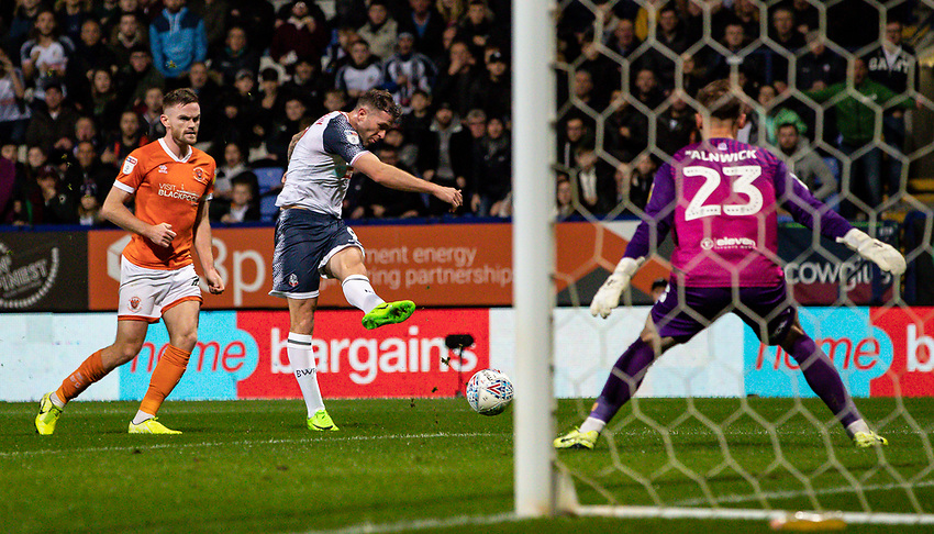 Bolton Wanderers' Daryl Murphy (centre) shoots at goal as Blackpool's goalkeeper Jak Alnwick (right) prepares to save<br /> <br /> Photographer Andrew Kearns/CameraSport<br /> <br /> The EFL Sky Bet League One - Bolton Wanderers v Blackpool - Monday 7th October 2019 - University of Bolton Stadium - Bolton<br /> <br /> World Copyright © 2019 CameraSport. All rights reserved. 43 Linden Ave. Countesthorpe. Leicester. England. LE8 5PG - Tel: +44 (0) 116 277 4147 - admin@camerasport.com - www.camerasport.com