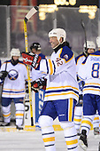Richard Smelik (42) greets teammates on the ice after The Frozen Frontier Buffalo Sabres vs. Rochester Amerks Alumni Game at Frontier Field on December 15, 2013 in Rochester, New York.  (Copyright Mike Janes Photography)