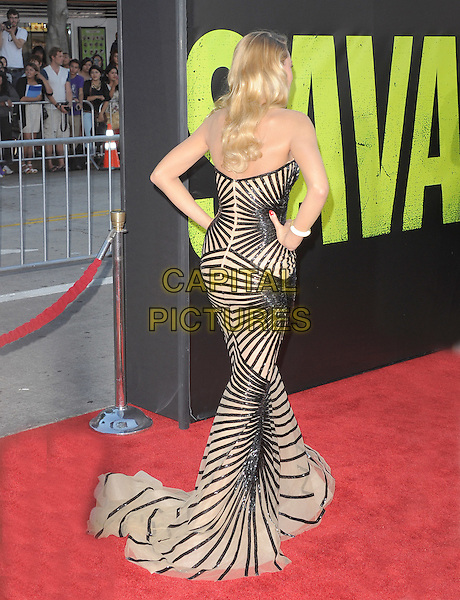 Blake Lively .The World Premiere of 'Savages' held at The Grauman's Chinese Theatre in Hollywood, California, USA..June 25th, 2012.full length black nude beige strapless striped stripes dress train hands on hips back behind rear.CAP/RKE/DVS.©DVS/RockinExposures/Capital Pictures.