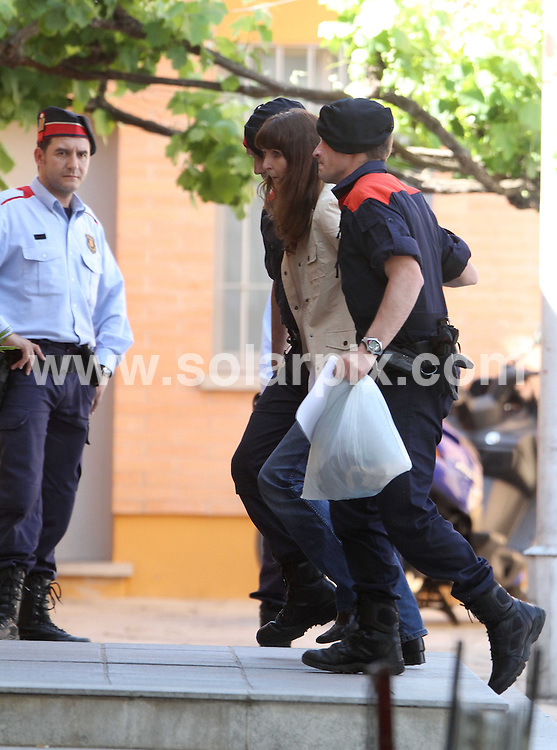 **PICTURES FROM SOLARPIX.COM**.**WORLDWIDE SYNDICATION RIGHTS**.Lianne Smith, the 43 year old mother who murdered her two children at the Hotel Miramar in Lloret de Mar, has now been charged with their murder and is on her way to Girona Prison to await trial. ..This pic: Lianne Smith is led into prison in Girona after appearing in court in Blanes accused of the murder of her two children...JOB REF:     11295   LRN     DATE:.**MUST CREDIT SOLARPIX.COM OR DOUBLE FEE WILL BE CHARGED**.**MUST NOTIFY SOLARPIX OF ONLINE USAGE**.**CALL US ON: +34 952 811 768 or LOW RATE FROM UK 0844 617 7637**