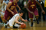 01/17/13--Jesuit Crusaders guard Jack Bell (22) dives for a loose ball against Central Catholic Rams' Cameron Scarlett (22) and LaMar Winston (4) in the first half at Knight Center.<br /> Photo by Jaime Valdez