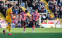 Lincoln City's Bruno Andrade, left, celebrates scoring the opening goal with team-mate Lee Frecklington<br /> <br /> Photographer Chris Vaughan/CameraSport<br /> <br /> The EFL Sky Bet League Two - Lincoln City v Northampton Town - Saturday 9th February 2019 - Sincil Bank - Lincoln<br /> <br /> World Copyright &copy; 2019 CameraSport. All rights reserved. 43 Linden Ave. Countesthorpe. Leicester. England. LE8 5PG - Tel: +44 (0) 116 277 4147 - admin@camerasport.com - www.camerasport.com