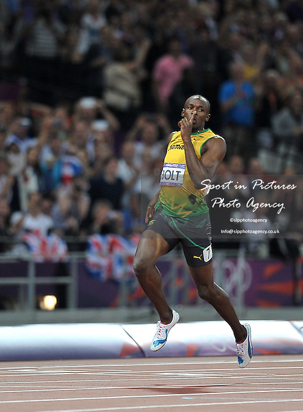 Jamaica's Usain Bolt wins. Athletics - PHOTO: Mandatory by-line: Garry Bowden/SIP/Pinnacle - Photo Agency UK Tel: +44(0)1363 881025 - Mobile:0797 1270 681 - VAT Reg No: 768 6958 48 - 09/08/2012 - 2012 Olympics - Olympic Stadium, Olympic Park, London, England