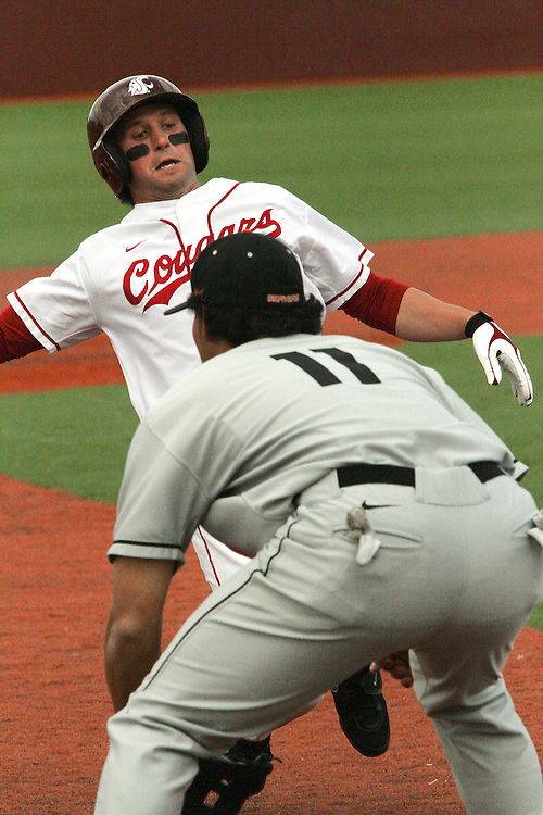 Washington State redshirt junior second baseman, Cody Bartlett (#2), slides safely in to third base during the Cougars Pac-10 conference tilt with Oregon State at Bailey-Brayton Field in Pullman, Washington, on April 24, 2010.