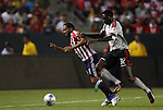 22 August 2009: Chivas USA's Maykel Galindo (CUB) (11) is fouled by Toronto's Emmanuel Gomez (32). CD Chivas USA played Toronto FC at the Home Depot Center in Carson, California in a regular season Major League Soccer game.