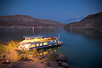 Houseboat parked on beach, Lake Powell
