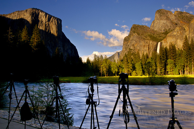 Cameras and tripods lined up at sunset next to the Merced River, Yosemite Valley, Yosemite National Park, California