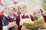 Tullyallen NS 1st Class students, Oisín McCann, Róisín Barrell and Katie Christie making a Christmas Cake with their teacher Ms Clarke...(Photo credit should read Jenny Matthews www.newsfile.ie)....This Picture has been sent you under the condtions enclosed by:.Newsfile Ltd..The Studio,.Millmount Abbey,.Drogheda,.Co Meath..Ireland..Tel: +353(0)41-9871240.Fax: +353(0)41-9871260.GSM: +353(0)86-2500958.email: pictures@newsfile.ie.www.newsfile.ie.