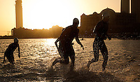 12 MAR 2011 - ABU DHABI, UAE - Competitors leave the water at the end of the first swim lap of the Abu Dhabi International Triathlon (PHOTO (C) NIGEL FARROW)