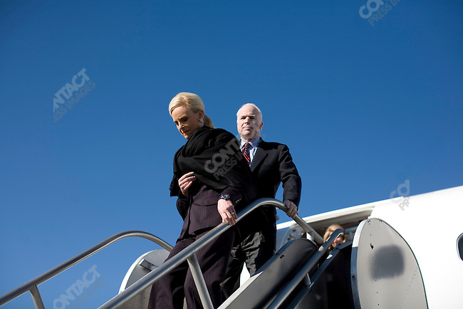 """Senator John McCain (R-AZ), potential Republican presidential candidate, and his wife, Cindy, disembark from the McCain campaign jet, having just flown to Nashville from Chicago, in part of a campaign push to gain """"Super Tuesday"""" votes. Nashville, Tennessee, February 2, 2008."""