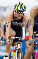 12 JUL 2014 - HAMBURG, GER - Vicky Holland (GBR) from Great Britain drafts Charlotte Bonin (ITA) from Italy  on the bike during the elite women's 2014 ITU World Triathlon Series round in the Altstadt Quarter in Hamburg, Germany (PHOTO COPYRIGHT © 2014 NIGEL FARROW, ALL RIGHTS RESERVED)