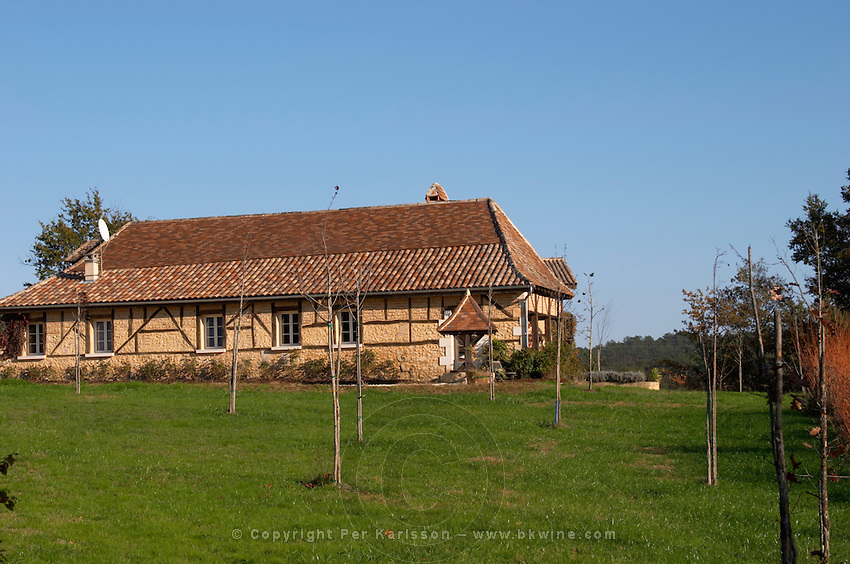 The farm house that is also a restaurant where duck specialities are served. Traditional Dordogne style with wooden cross beams and bricks. Ferme de Biorne duck and fowl farm Dordogne France
