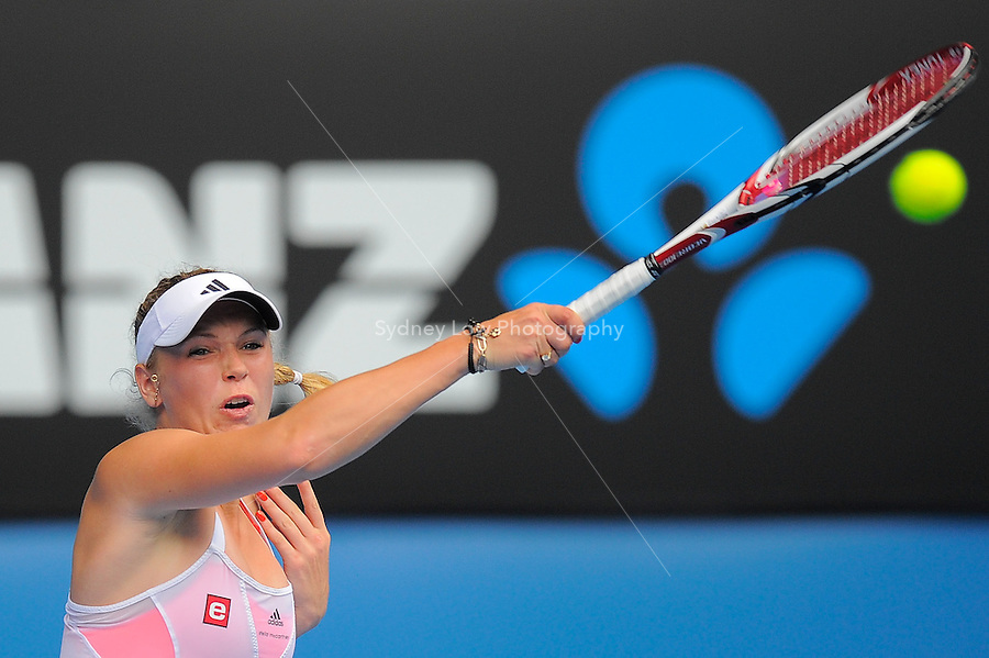 MELBOURNE, 17 JANUARY - Caroline Wozniacki (DEN) in action during her first round match against Gisela Dulko (ARG) on day one of the 2011 Australian Open at Melbourne Park, Australia. (Photo Sydney Low / syd-low.com)