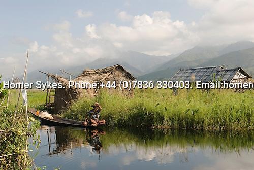 Fisherman rows his boat Lake Inle, Sankar and Kakku region. Myanmar (Burma.) 2006