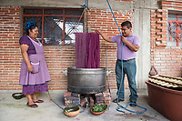 Master dyer and rug weaver Fidel Cruz Lazo, his wife Maria Luisa Mendoza de Cruz and their son Luis David all work together to dye yarn with the grano cochinilla at their home and workshop Casa Cruz, Avenida Juarez 190, Teotitlan del Valle, Oaxaca, Mexico