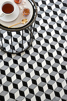 Euclid Grand, a hand-cut mosaic shown in honed Chinese Black, honed Allure and polished Dolomite, is part of the Illusions® collection by New Ravenna.