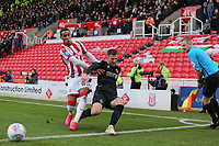 Ben Purrington of Charlton tackles Thomas Ince of Stoke City during Stoke City vs Charlton Athletic, Sky Bet EFL Championship Football at the bet365 Stadium on 8th February 2020