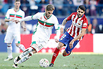 Atletico de Madrid's Augusto Fernandez (r) and Granada Club de Futbol's Ruben Rochina during La Liga match. April 17,2016. (ALTERPHOTOS/Acero)