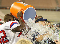 Manatee Hurricanes Darius White #52 and Leon Allen #7 dump the water on head coach Joe Kinnan during the fourth quarter of the Florida High School Athletic Association 7A Championship Game at Florida's Citrus Bowl on December 16, 2011 in Orlando, Florida.  Manatee defeated First Coast 40-0.  (Mike Janes/Four Seam Images)