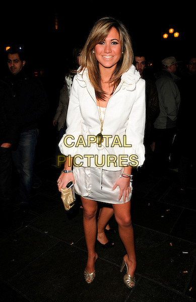 CIARA JANSEN.The Paper Club Brit Awards afterparty, 68 Regent Street, London, England..February 20th, 2008.after party brits full length white jacket cream skirt clutch bag purse gold.CAP/CAN.©Can Nguyen/Capital Pictures.