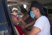 Johnathan Hinojosa of Rogers (right) administers a nasal swab to Justin Gonzalez, 4, (left), Friday, June 26, 2020 during a mass covid-19 screening at the Northwest Arkansas Community College in Bentonville. The Arkansas Department of Health hosted a mass screening for anyone at the campus. Their goal was to administer 500 covid-19 tests. NWACC provided the facility and volunteers. UAMS and Mercy Hospital also provided volunteers. Check out nwaonline.com/200627Daily/ for today's photo gallery. <br /> (NWA Democrat-Gazette/Charlie Kaijo)