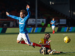 Harry Forrester goes down in the box as Adam Barton challenges