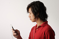 Montreal (Qc) CANADA ,August 2008 -<br /> Model Released photo -<br /> <br /> 17 year old male asian (Vietnamese) teen using a APPLE IPOD (tm) MP-3 Player.<br /> <br /> photo : (c) images Distribution