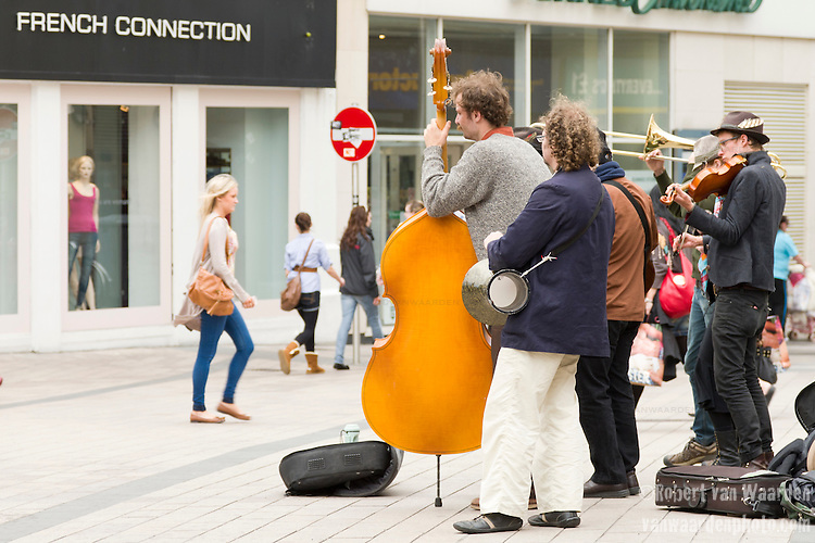 Musicians preforming in Belfast square