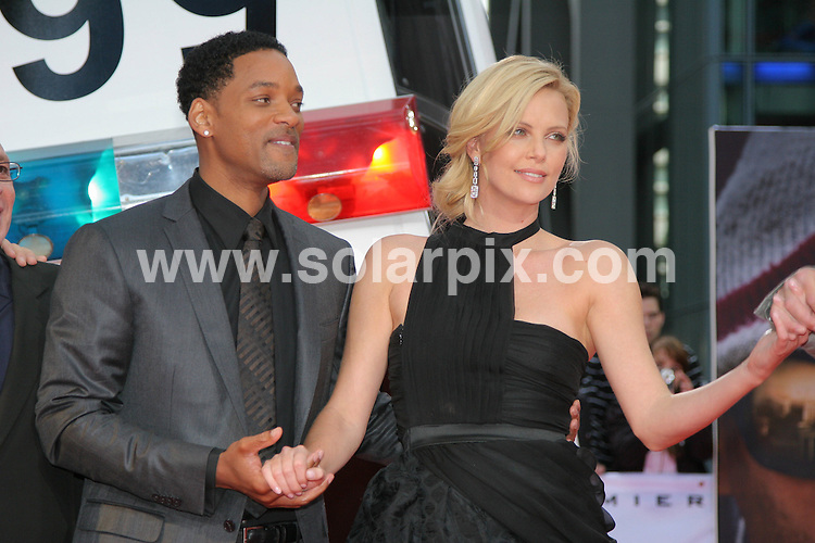 **ALL ROUND PICTURES FROM SOLARPIX.COM**.**SYNDICATION RIGHTS FOR UK AND SPAIN ONLY**.The Hollywood Actor Will Smith and actress Charlize Theron at the red carpet  premiere of his movie Hancock at the Sony center in Berlin in Germany..This pic:will Smith,Charlize Theron.JOB REF: 6666-CPR/Michael Gottschalk  DATE:17-06_08.**MUST CREDIT SOLARPIX.COM OR DOUBLE FEE WILL BE CHARGED* *UNDER NO CIRCUMSTANCES IS THIS IMAGE TO BE REPRODUCED FOR ANY ONLINE EDITION WITHOUT PRIOR PERMISSION*