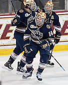 Kevin Lind (ND - 25), Thomas DiPauli (ND - 14), T.J. Tynan (ND - 18) - The visiting University of Notre Dame Fighting Irish defeated the Boston College Eagles 7-2 on Friday, March 14, 2014, in the first game of their Hockey East quarterfinals matchup at Kelley Rink in Conte Forum in Chestnut Hill, Massachusetts.