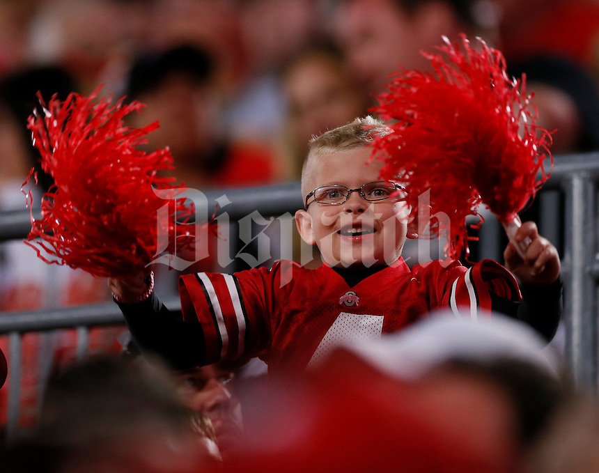 A young Ohio State Buckeyes fan waves pompoms during Saturday's NCAA Division I football game against Wisconsin at Ohio Stadium in Columbus on September 28, 2013. (Barbara J. Perenic/Columbus Dispatch)