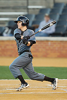 Colin Hawk (2) of the Cincinnati Bearcats follows through on his swing against the Wake Forest Demon Deacons at Wake Forest Baseball Park on February 21, 2014 in Winston-Salem, North Carolina.  The Bearcats defeated the Demon Deacons 5-0.  (Brian Westerholt/Four Seam Images)