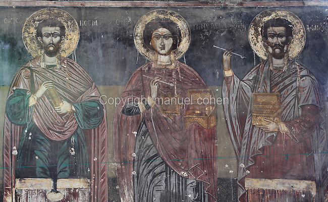 Fresco of saints holding boxes in the nave of the Dormition of Saint Mary Cathedral Church, or Kisha Katedrale Fjetja e Shen Marise, built 1699, Voskopoje, Korce, Albania. The church contains frescoes by Theodor Anagnost and Sterian from Agrapha in Greece, and the large icons in the iconostasis were painted 1703 by Constantine Lemoronachos. Picture by Manuel Cohen
