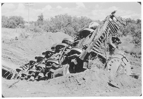 Engine #483 upside down in the dirt.  View of bottom of engine.<br /> D&amp;RGW  Bocea Hill in Durango area, CO  Taken by Payne, Andy M. - 9/27/1958