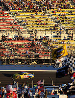 Aug 31, 2008; Fontana, CA, USA; NASCAR Sprint Cup Series driver Bobby Labonte races past a half empty grandstand during the Pepsi 500 at Auto Club Speedway. Mandatory Credit: Mark J. Rebilas-
