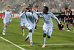 10 March 2012: Kansas City's C.J. Sapong (center) celebrates scoring the game's only goal with Kei Kamara (SLE) (23). Aurelien Collin (FRA) (78) and Jacob Peterson (left) join the chase. Sporting Kansas City defeated DC United 1-0 at RFK Stadium in Washington, DC in a 2012 regular season Major League Soccer game.