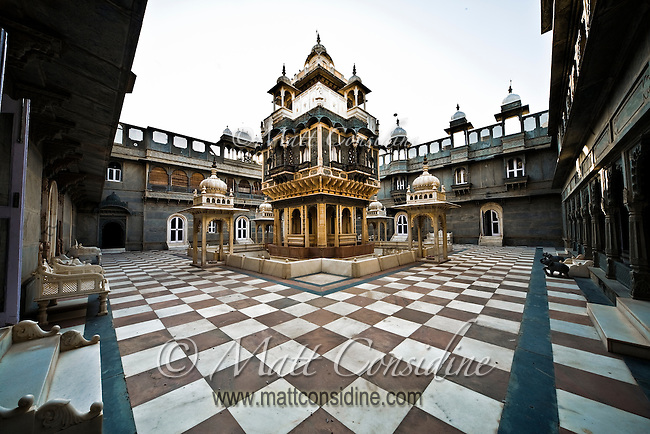 The courtyard of a palace with secure elevated central room with moat.<br /> (Photo by Matt Considine - Images of Asia Collection)