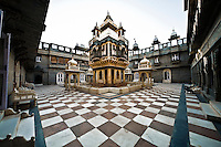 The courtyard of a palace with secure elevated central room with moat. (Photo by Matt Considine - Images of Asia Collection)