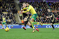 Josh Murphy of Norwich City under pressure from Shaun Hutchinson of Millwall during Norwich City vs Millwall, Sky Bet EFL Championship Football at Carrow Road on 1st January 2018