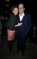 "KEELEY HAWES & MATTHEW MACFADYEN.At the ""Private Lives"" Press Night, Vaudeville Theatre, London, England, UK, March 3rd 2010..full length grey gray jacket red and white polka dot dress black tights booties ankle boots cross body strap bag blue suit glasses married couple husband wife white shirt hand arm around .CAP/CAN.©Can Nguyen/Capital Pictures."