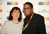 Herbie Hancock and his wife, Gigi Hancock, arrive for the formal Artist's Dinner honoring the recipients of the 40th Annual Kennedy Center Honors hosted by United States Secretary of State Rex Tillerson at the US Department of State in Washington, D.C. on Saturday, December 2, 2017. The 2017 honorees are: American dancer and choreographer Carmen de Lavallade; Cuban American singer-songwriter and actress Gloria Estefan; American hip hop artist and entertainment icon LL COOL J; American television writer and producer Norman Lear; and American musician and record producer Lionel Richie. Photo Credit: Ron Sachs/CNP/AdMedia