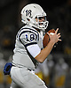 Oceanside quarterback No. 18 Vincent Guarino finds himself on the receiving end of a pass which he caught for a 53-yard touchdown during a Nassau County varsity football Conference I semifinal against Massapequa at Hofstra University on Saturday, Nov. 14, 2015.<br /> <br /> James Escher