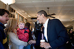 Sunday December 10th, 2006,  Portsmouth, New Hampshire.3 year old Daniel Bachmann and his mother Kathleen greet the Senator at his coffee stop..Illinois Senator Barack Obama visited Portsmouth, New Hampshire today to sign his new book and speak a message of hope to his assembled supporters who helped him sell out two packed convention halls. . He signed books and visited a local coffee shop on his way to Manchester for a New Hampshire Democratic Party fund raiser.<br />