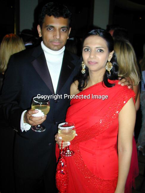 M. Night Shylamalan &amp;wife<br />2000 Vanity Fair Post Oscar Party<br />Morton's Restaurant<br />Los Angeles, California, USA<br />March 26, 2000<br />Photo by Celebrityvibe.com