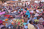 People waking up the morning after sleeping in the open in a camp for over 5,000 internally displaced persons in an Episcopal Church compound in Wau, South Sudan. Most of the families here were displaced by violence early in 2017, after a larger number took refuge in other church sites when widespread armed conflict engulfed Wau in June 2016.<br /> <br /> Norwegian Church Aid, a member of the ACT Alliance, has provided relief supplies to the displaced in Wau, and has supported the South Sudan Council of Churches as it has struggled to mediate the conflict in Wau.