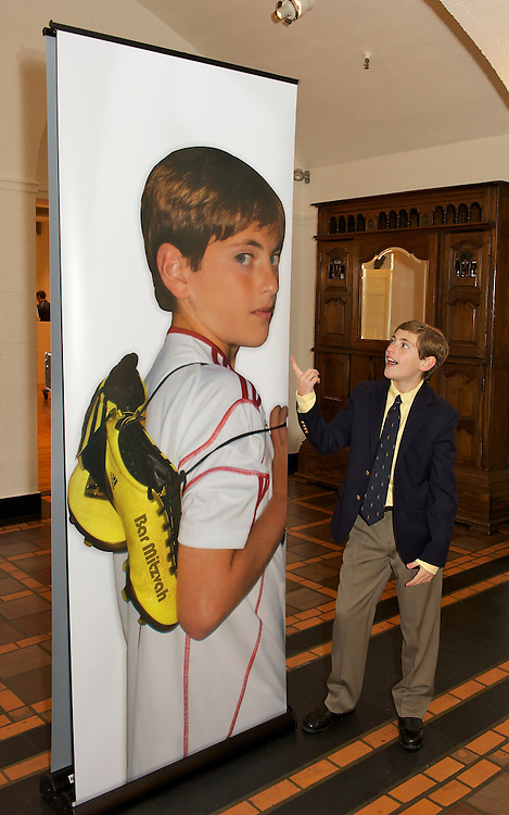 Bar Mitzvah Boy posing with poster at Mountain Ridge Country Club, West Caldwell, NJ