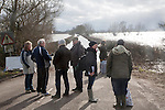 Flooding on the Somerset Levels, England in February 2014 - people waiting at Huish Episcopi for humanitarian support boat service to Muchelney village