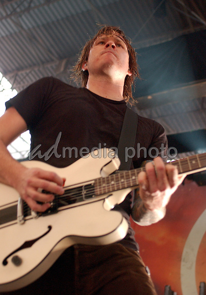 June 27, 2006; Pittsburgh, PA, USA:  Guitarist  and singer TOM DELONGE (formerly of BLINK 182) performs with his new band, ANGELS & AIRWAVES held at the Chevrolet Ampitheatre.  Mandatory Credit:  Photo by Jason L Nelson/AdMedia  © Copyright 2006 by Jason L Nelson.