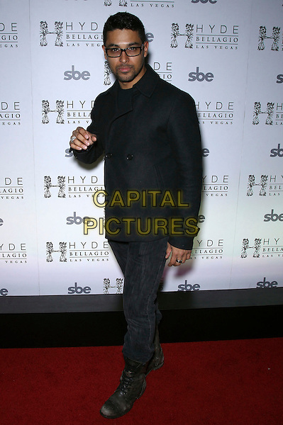 Wilmer Valderrama.celebrates his 33 birthday at Hyde Bellagio, Las Vegas, NV, USA,  .2nd  February 2013..full length black coat jeans glasses .CAP/ADM/MJT.© MJT/AdMedia/Capital Pictures.