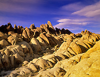 Rock formations in Alabama Hills with lenticular cloud, California